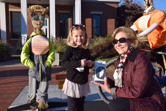 Maggie, age 4, assisted by BPAC member Ellen Weiss, drew the ticket for Emily Eisenlohr, wh